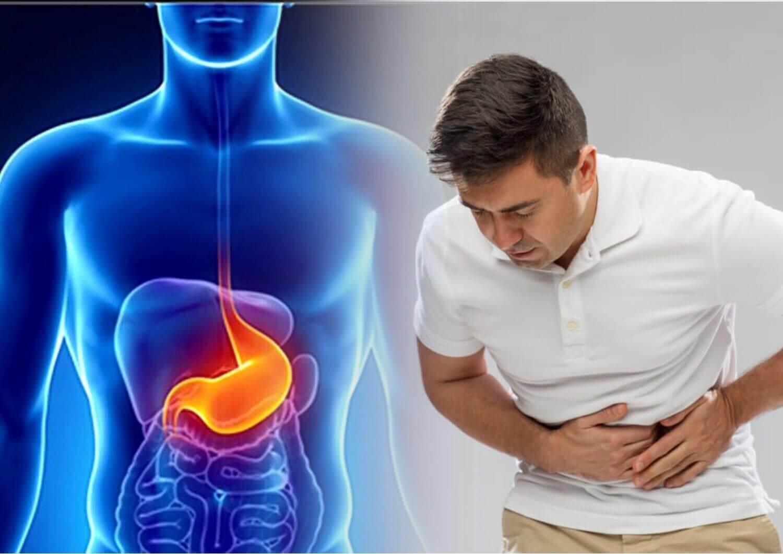 болит желудок после переедания